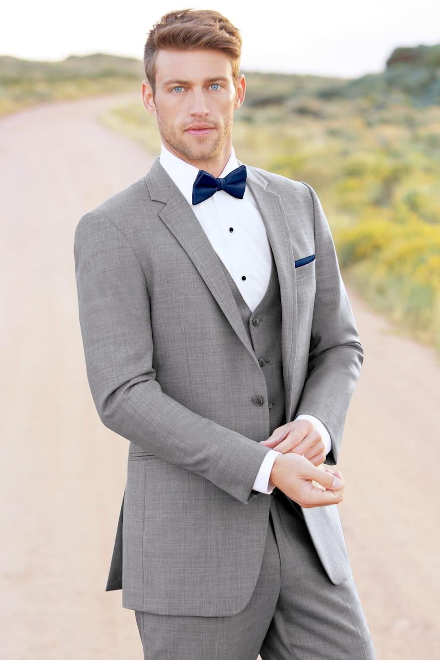 Groom in light grey tuxedo